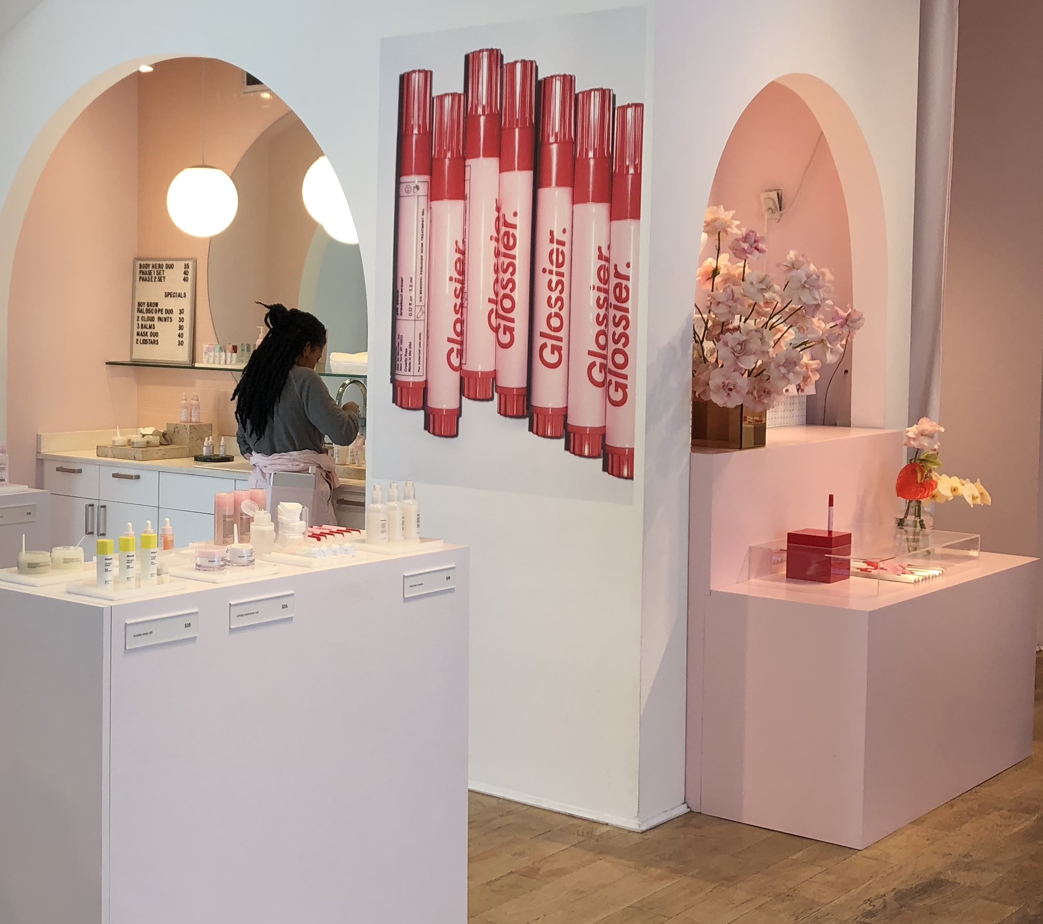 Glossier physical location delightful customer experience